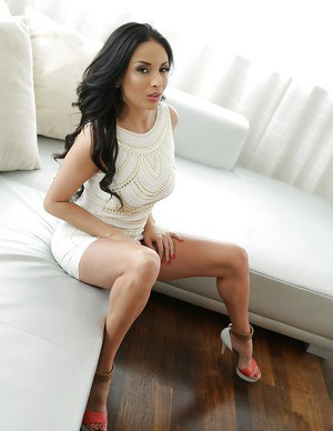 Sexy Euro pornstar Anissa Kate showing off great legs in sheer panties