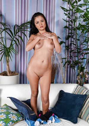 Mature Asian broad Jacky Fay-Lynn spread shaved and pierced vagina in barefeet