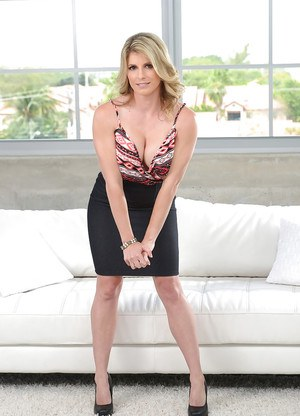 Sexy MILF Cory Chase reveals round tits before removing black skirt