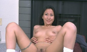 Asian first timer Lisa revealing big natural tits while undressing