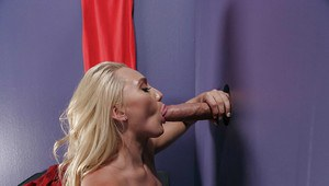 Blonde slut AJ Applegate sucking off large penis at gloryhole