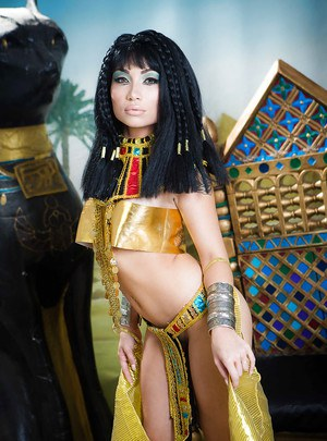 Brunette coed Rina Ellis freeing bare ass from Cleopatra outfit
