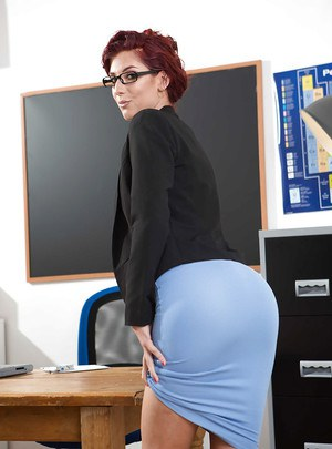 Glasses attired Euro teacher Shona River posing naked on desk after disrobing