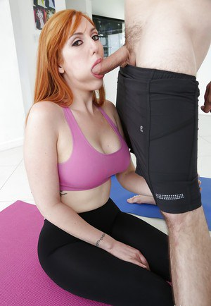 Natural redheaded pornstar Lauren Phillips sucking off big dick in yoga pants