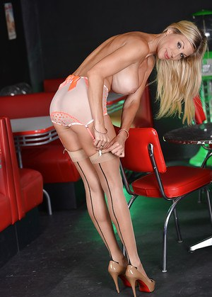 Tall MILF in high heels Puma Swede squeezes her boobs and plays with pussy