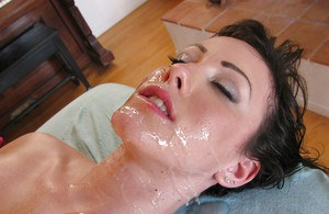 Oiled up stunner Jennifer White spreads legs to get her bald pussy fingered