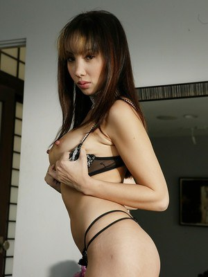 Hot Asian model Katsuni releasing firm breasts from bra in teasing fashion