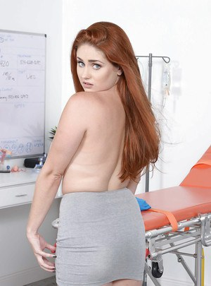 Chubby redhead Lennox Luxe letting boobs loose from black bra
