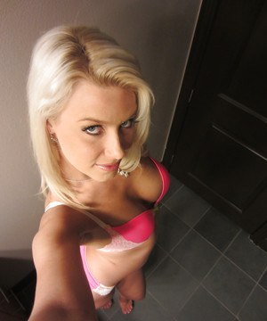 Blonde chick Anikka Albrite taking mirror self shots while getting undressed