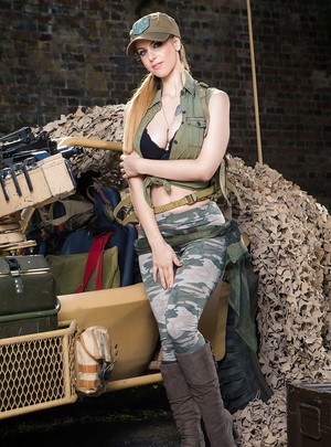 Pornstar Stella Cox letting big natural tits loose from military garb