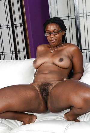 Chubby black amateur Janelle Taylor stripping naked on couch wearing glasses