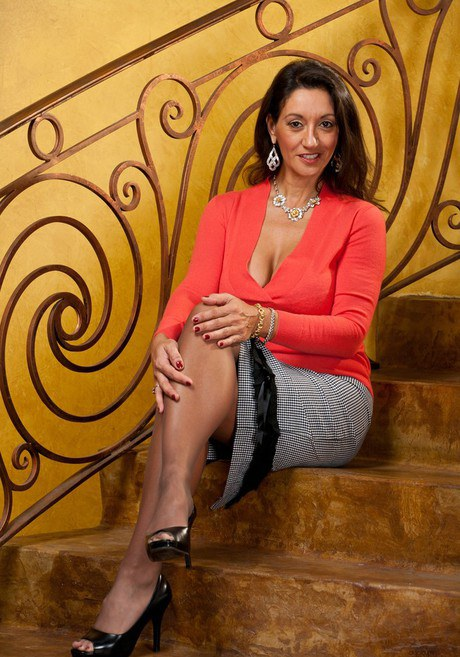 Matured woman Persia Monir uncovering to hosiery and heels on the stairs