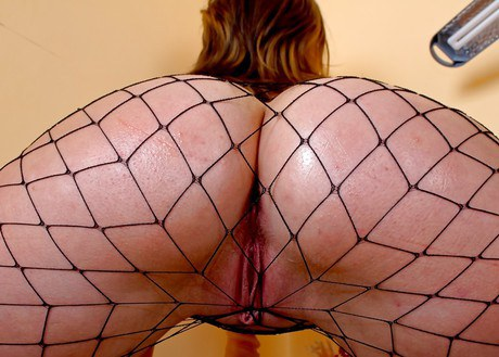 Libidinous homemaker in fishnet tights gets her rear greased and acts with a terrific vibrator
