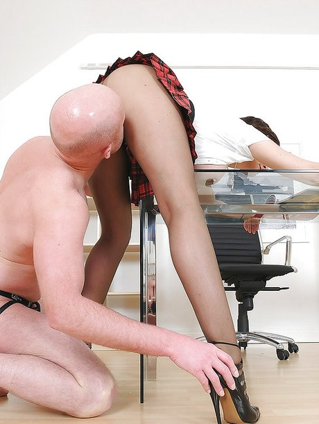 Mature femdom in tights holds some ass lapping pleasure with her male pet