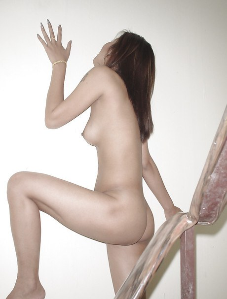 Asian nymph with mini tits named Wann lengthening legs on the stairs