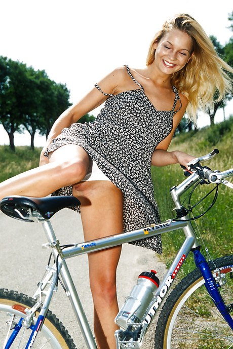 Close up outdoor posing featuring teenager girly Zuzana g on a bicycle