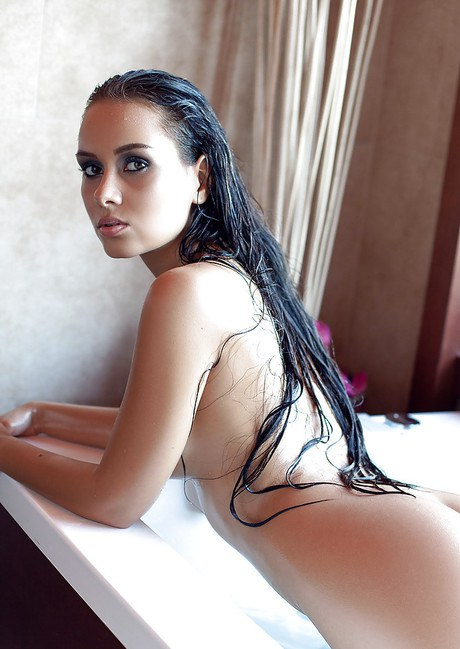 Curvaceous model Vivien cavorting her gigantic hooters in the lavatory