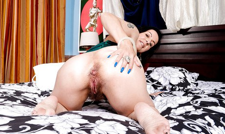 Older model Nina Swiss displaying her stained toes and woolly cooter