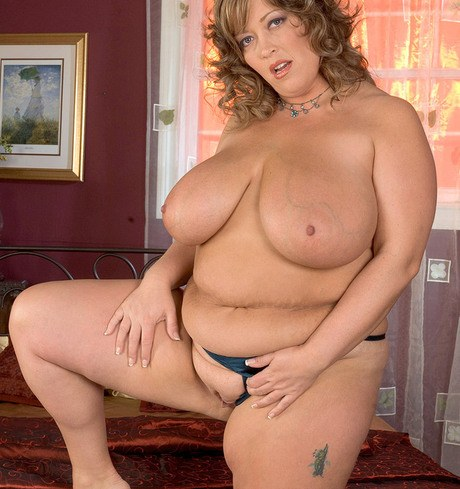 Big-beautiful-woman Savannah Phair removes her silk housecoat and lingerie to pose undressed