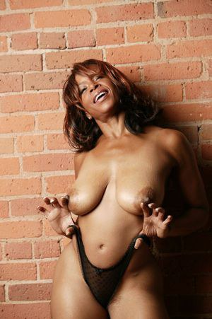 Big titted ebony mature Semmie Desuora flaunting with her nice titties uncovered