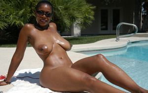 Black mature Semmie Desuora stripping from bikini and masturbating at the pool