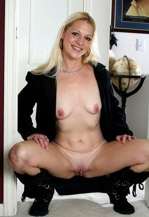 Mature blonde in boots showing off tiny tits and spreading shaved pussy