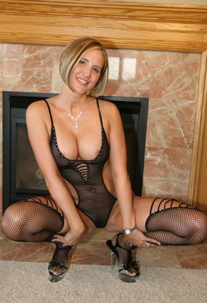 Luscious mom Desirae Spencer flaunting in black see-thru lingerie and stripping