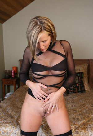 Desirae Spencer reveals her nice boobs and hairy snatch from sheer bodystocking