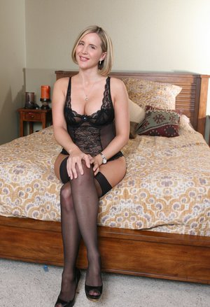 Busty housewife in black lacey lingerie and stockings Desirae Spencer stripping
