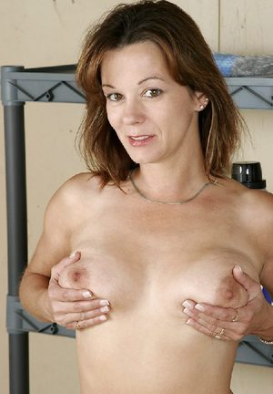 Adorable mom sitting on a washing machine with her boobs and small bush exposed