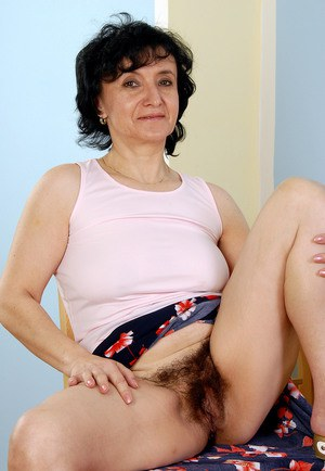 Old big breasted granny takes off her skirt and shows off her old hairy muff.