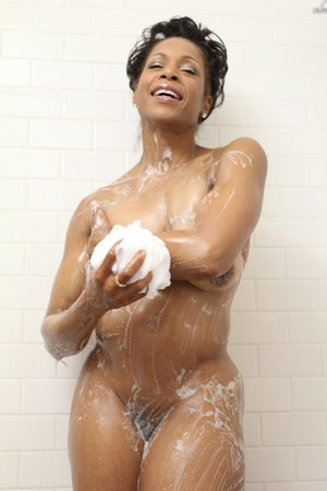 Smoking hot Semmie Desuora takes off her black thongs and takes a hot soapy shower.