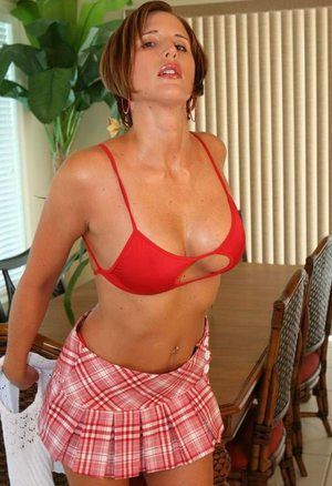 Busty housewife lady Desirae Spencer shows off her superb fit ass in very sexy red