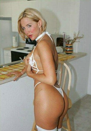 Lovely blonde housewife Desirae Spencer shows off her superb hot body in very expensive and slutty white lingerie and high heels.