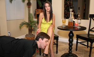 Femdom slave takes off high heels to worship soles