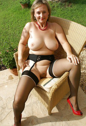 Mature bbw in stockings spreading her shaved pussy and plays with her big tits