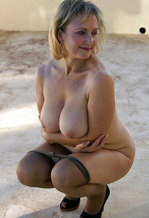 Mature fatty in pantyhose squeezing her huge melons and masturbating outdoor