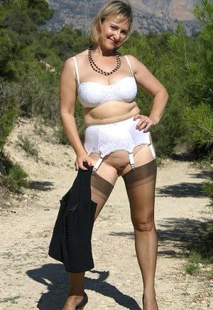 Chubby mom in stockings denudes outdoor and spreading her shaved twat