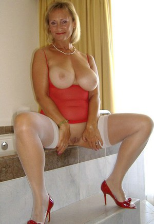 Busty blond mom in stockings playing with her big titties in the bath