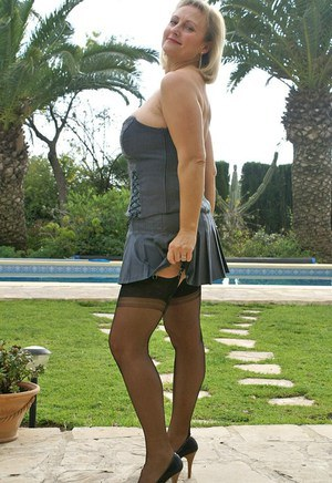 Delicious fatty in stockings and high heels fondling her massive boobs outdoor