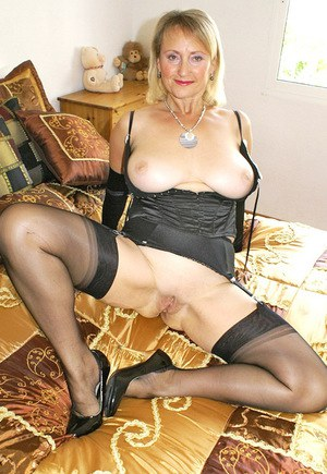Old fatty in black lingerie spreading and fondling her shaved pussy