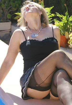Mature fatty in black stockings has her shaved pussy exposed for upskirt shots