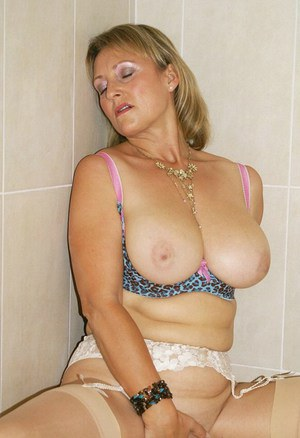 Busty fatty in high heels masturbating her mature pussy in the shower