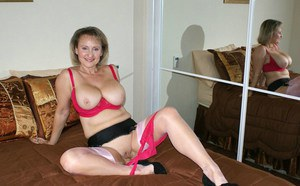 Old fatty in stockings pleasing a cock with her shaved twat and big tits