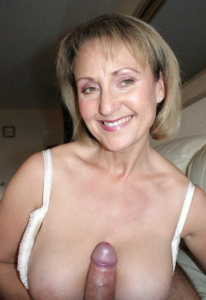 Plump mommy in stockings giving an amazing titjob with her huge melons