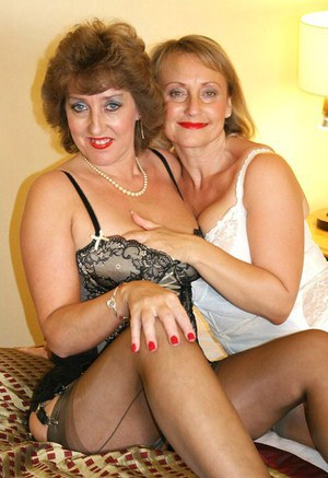 BBW mature lesbo scene with two fatties in stockings pleasing each other