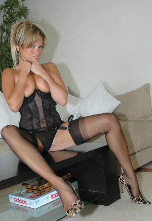 Lubricious blonde exposing her insanely sexy body in lingerie and stockings