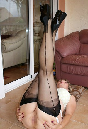 Mature bbw in gartered stockings pleasing a cock with her hands and mouth