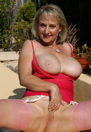 Mature plumper in shiny stockings toying her tits and pussy at the pool