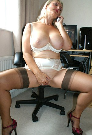 Busty mom in white underwear masturbating while talking on the phone